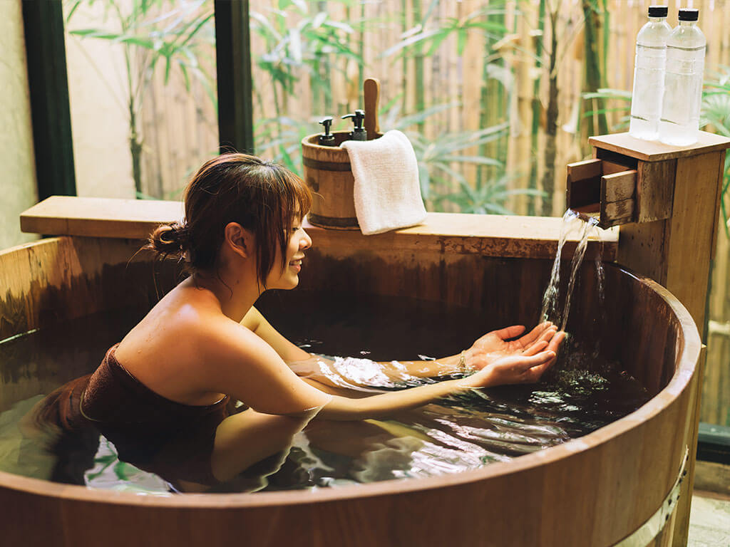 Japanese woman bathing in a open-air hot spring onsen in Nagoya
